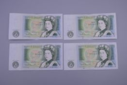 Four consecutive £1 bank notes.