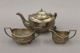 A silver composite bachelor's tea set. The teapot 10.5 cm high. 12.6 troy ounces.