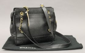 A Chanel Grand Shopping Tote bag in black grained leather, with embossed logos,