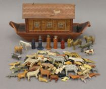 A Folk Art painted wooden Noah's Ark and wooden animals. The ark 40 cm long.