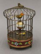 A cloisonne birdcage clock. 19 cm high.