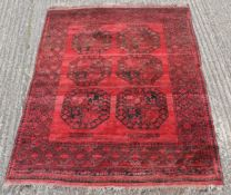 A black and red rug. 140 x 150 cm.