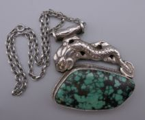 A large Oriental silver and turquoise pendant on a sterling silver chain. The pendant 7 cm wide.