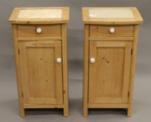 A pair of 19th century Continental pine pot cupboards. Each 81 cm high.