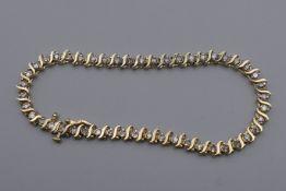 A 14 K gold diamond tennis bracelet with forty-seven diamonds, 0.
