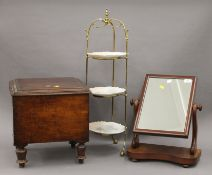 A Victorian toilet mirror, a commode and a brass and porcelain three-tier cake stand.
