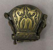 An antique Islamic brass scribes pot. 5 cm high.