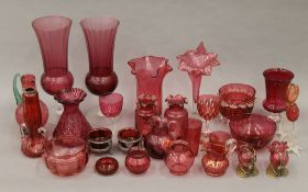 A collection of various cranberry glass.