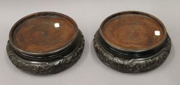 A pair of 19th century Chinese carved wooden, possibly Hongmu urn stands. 27 cm diameter.