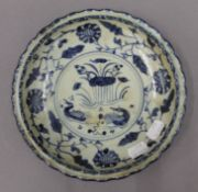 A Chinese blue and white porcelain dish. 21 cm diameter.