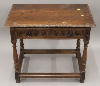 An 18th century style carved oak single drawer side table. 80 cm wide.