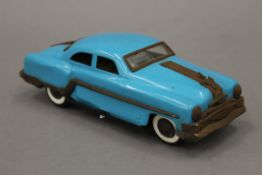 A 1950s tin plate Pontiac Rock and Roller friction car. 25 cm long.