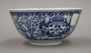 A 19th century Chinese blue and white porcelain bowl, the underside with four character mark.