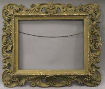A Venetian carved wooden frame. external size 68.5 x 58.5 cm, inner size 46 x 36 cm.