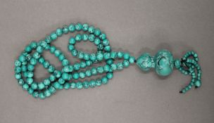 A turquoise bead necklace. 82 cm long.