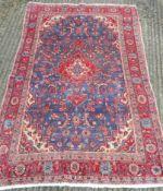 A red and blue ground Hamadan carpet. 215 x 130 cm.