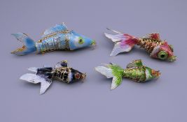 Four enamel decorated fish. The largest 8 cm long.