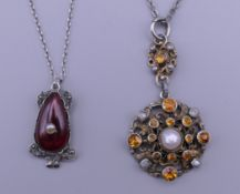 A silver garnet and pearl pendant and chain,