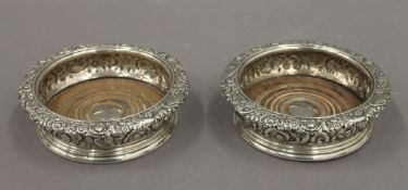 A pair of silver coasters. 16 cm diameter. 21.3 troy ounces total weight.