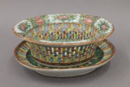 A 19th century Canton porcelain basket on stand. The stand 22 cm wide.