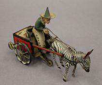 A Lehman tin plate clockwork model of a zebra and cart. 18 cm long.