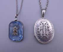 An ornate antique silver locket and chain, and a blue cut crystal and silver pendant and chain.
