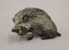A cold painted bronze model of a boar. 6 cm long.