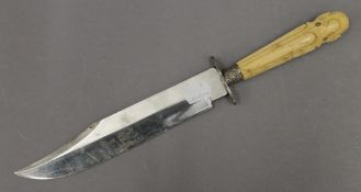 A 19th century ivory handled bowie knife. 34.5 cm long.