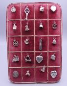 A vintage jewellery stand set with 20 silver charms.