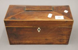 A Victorian mahogany sarcophagus tea caddy with mixing bowl. 31 cm wide.