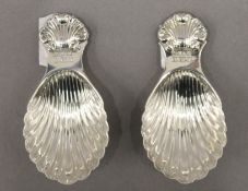 Two silver shell bowl caddy spoons. 8 cm long. 42.7 grammes.
