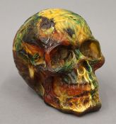 A model of a skull. 14 cm high.