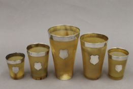 Five silver mounted horn beakers. The largest 12.5 cm high.