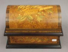 A modern Swiss inlaid burr wood music box. 32 cm wide.