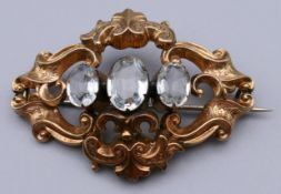 A Victorian unmarked gold paste set brooch. 5 cm wide. 7.2 grammes total weight.