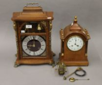 An Edwardian inlaid mahogany mantle clock and another. The former 34 cm high.
