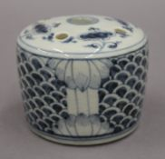 A Chinese blue and white porcelain brush holder. 8 cm high.