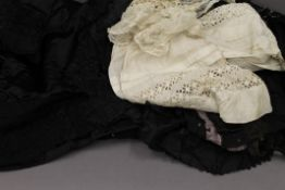 A quantity of Victorian lace clothing, etc.