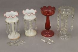 A pair of Victorian milk glass lustres, a cranberry glass lustre and a clear glass lustre.