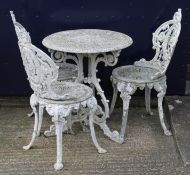 A set of three garden chairs and a table
