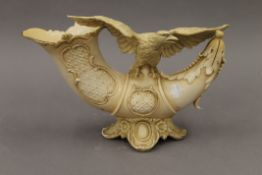 A 19th century Rudolstadt porcelain model of an eagle on a cornucopia. 23.5 cm high.