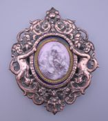 A 19th century copper and enamel plaque in a 19th century frame. 10.5 cm high.