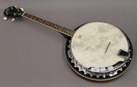 An Irish short neck tenner banjo. 83 cm long.