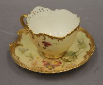 A Royal Worcester blush ivory cup and saucer. The cup 10 cm wide.