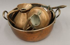 A quantity of copperware, including a large twin handled preserving pan. 53 cm wide.
