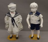 A pair of child mannequins. Each approximately 82 cm high.
