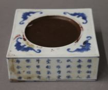 A Chinese blue and white porcelain ink stone. 12.5 cm diameter.