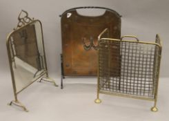 Three vintage spark guards. The largest 70 cm high.