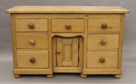 A Victorian pine seven drawer dresser base. 133 cm wide.