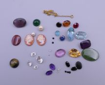 A quantity of assorted gemstones, etc.